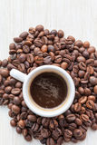 Coffee in cup on coffee beans Royalty Free Stock Images