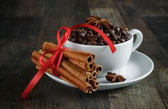 Coffee cup, coffee beans, spices, anise, cinnamon royalty free stock photo