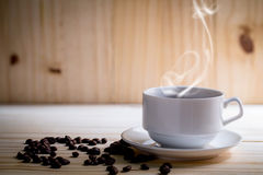 Coffee cup and coffee beans with stream Royalty Free Stock Photography