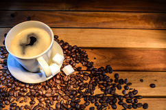 Coffee cup with coffee beans. And sugar cubes Stock Images