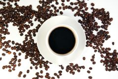 Coffee cup and coffee beans on white background Royalty Free Stock Image
