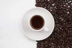 Coffee cup and coffee beans on white background Stock Photography
