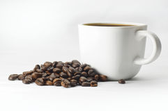 Coffee Cup and coffee beans on white background Stock Photos