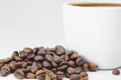 Coffee Cup and coffee beans on white background Royalty Free Stock Images