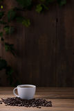 Coffee cup and coffee beans on wooden Stock Photos