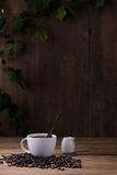 Coffee cup and coffee beans on wooden Royalty Free Stock Image