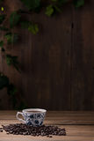 Coffee cup and coffee beans on wooden Stock Images