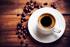 Coffee cup with coffee beans  on wooden background with copyspac Royalty Free Stock Photography