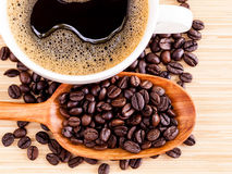 A Coffee cup and coffee beans Royalty Free Stock Photo
