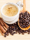 A Coffee cup and coffee beans on  wooden panel Stock Image