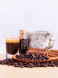 A Coffee cup and coffee beans on  wooden panel Royalty Free Stock Image