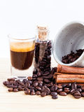 A Coffee cup and coffee beans on  wooden panel Royalty Free Stock Photo