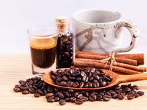A Coffee cup and coffee beans on  wooden panel. Stock Photos