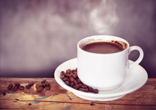 Coffee cup and coffee beans on a wooden table Stock Photo