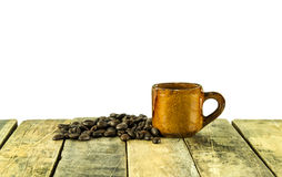 Coffee cup and coffee beans on wooden on white background Royalty Free Stock Photos