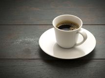 Coffee Cup. Full of black coffee on a wooden background Stock Images