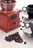 Coffee cup with coffee grinder Royalty Free Stock Photography