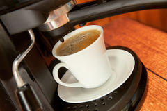 The coffee cup in coffee machine Stock Images