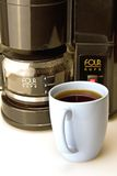 Coffee Cup and Coffee Maker. Fresh brewed coffee and black coffee maker stock images