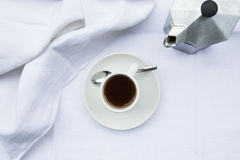 Coffee cup and coffee maker Royalty Free Stock Photo