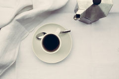 Coffee cup and coffee maker Stock Photos