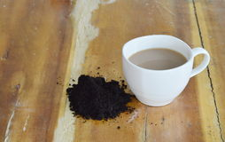 Coffee cup and coffee scrub Stock Photos