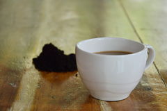Coffee cup and coffee scrub Royalty Free Stock Images