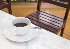 Coffee cup in coffee shop Royalty Free Stock Image