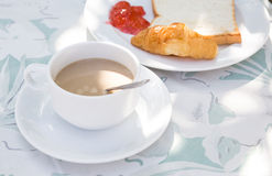 Coffee cup in coffee shop and Bread Stock Images