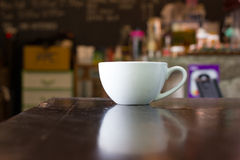 Coffee cup in coffee shop. Stock Image