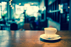 Coffee cup in coffee shop. Vintage instagram effect filter Royalty Free Stock Photography