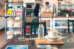 Coffee cup in coffee shop Stock Image