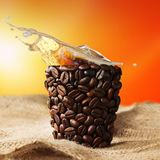 Coffee cup with coffee splash Stock Photos