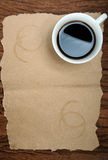 Coffee cup with coffee stains on sheets of paper Stock Photography