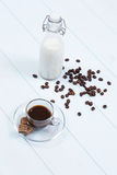 Coffee cup with coffee, sugar and milk. Coffee cup full of coffee, sugar and milk on a wood table Stock Images