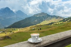 Coffee cup in coffee time on mountain view background royalty free stock photography