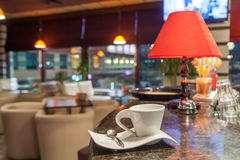 Coffee cup at coffeeshop. Interior Royalty Free Stock Photo