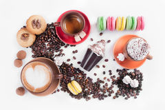 Coffee cup with color dessert macaroon, tiramisu cake Stock Images