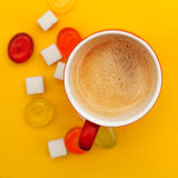 Coffee cup and colorful candies Stock Photography
