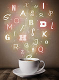 Coffee cup with colorful letters Royalty Free Stock Photo