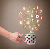 Coffee cup with colorful letters Stock Photography