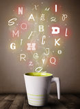 Coffee cup with colorful letters Stock Image