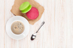 Coffee cup, colorful macarons and spoon Royalty Free Stock Images