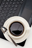 Coffee cup and computer Stock Photography