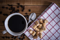 Coffee cup and cookie collon on wooden background. Coffee cup and cookie collon on wooden background royalty free stock photo