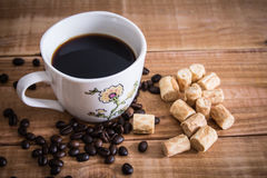 Coffee cup and cookie collon on wooden background. Coffee cup and cookie collon on wooden background stock image