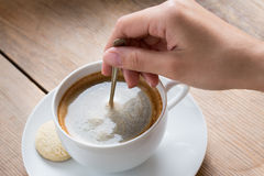 Coffee cup with cookie Stock Photos