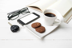 Coffee cup with cookie,phone,open notebook,car key and eyeglasse Royalty Free Stock Photos