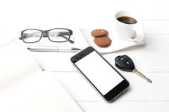 Coffee cup with cookie,phone,open notebook,car key and eyeglasse Stock Photography