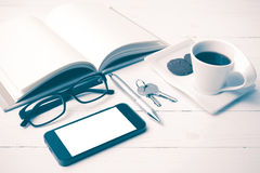 Coffee cup with cookie,phone,open notebook,key and eyeglasses vi Royalty Free Stock Image